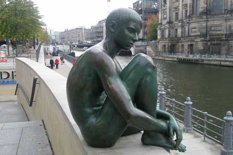 Bronze life size outdoor Sculpture Quiet Boy Near the River